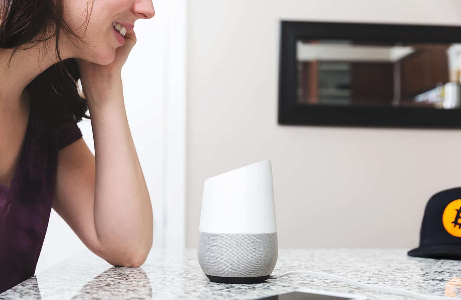 Lady talking to a Google Home